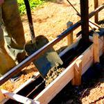 Установка фундамента для металлических заборов